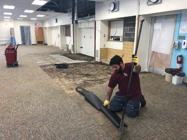 man working on carpet tiles