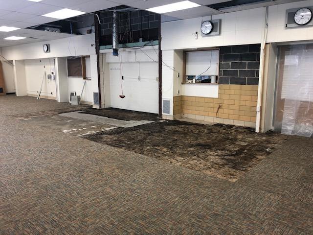 torn up carpet tiles