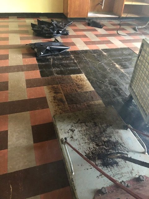 fake tile floor being removed