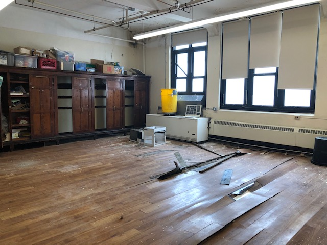 floor being torn up in a classroom