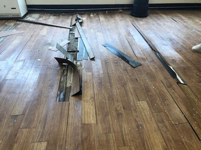 badly damaged wood floor