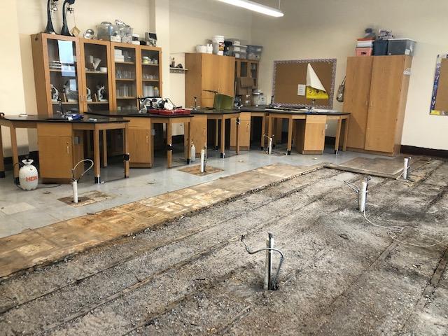 torn up floor in a classroom